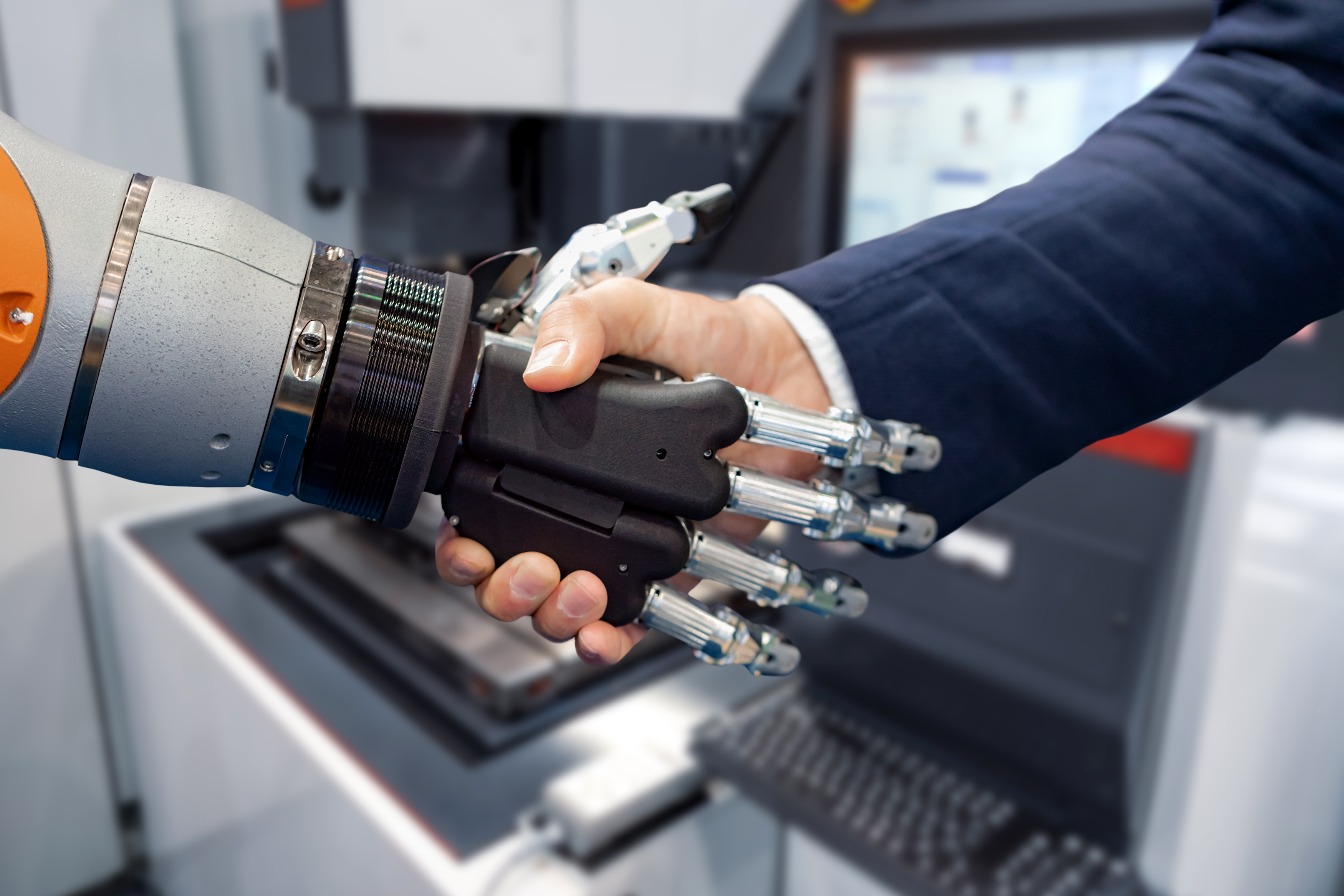 hand-of-a-businessman-shaking-hands-with-a-android-D5M6JNV